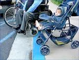 wheelchair and baby in a stroller at a curb cut
